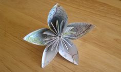 Map flower to make. This would be lovely on top of a gift instead of a bow.