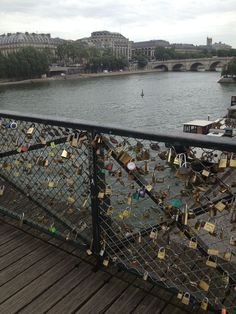 Le Pont des Amoureux or Lover's Bridge in Paris. Couples have taken to attaching padlocks to the bridge then throwing the key into the river below, as a romantic gesture. So it's fitting that Le Pont des Arts is the bridge where Carrie and Big rendezvous in the final episode of Sex and the City.