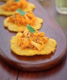 This tostones recipe, the quintessential Puerto Rican accompaniment, comes from Chef José Santaella's cookbook Cocina Tropical.