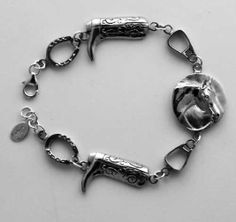 Western Pleasure Horse Bracelet in Sterling Silver. Starting with Western Pleasure Horse Head, Western Stirrups, Cowboy Boots, Horsehoes.