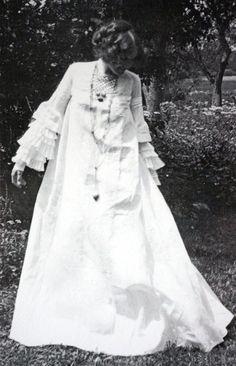 Emilie Flöge  in a dress designed by Gustav Klimt. Photography taken at the Attersee. 1906