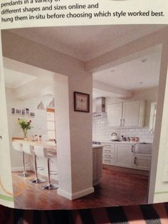 Open plan kitchen diner with pillar...