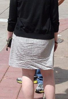 A very ordinary dress until I saw the back of it. Love the way she's wrinkled it!