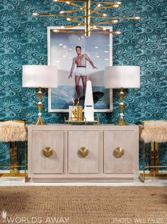 Elvis approved✔ This room features our Hearst bar stool, Bailey cabinet, and Benson sputnik chandelier. Worlds Away