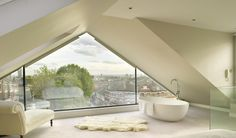 Raising the roof: dramatic glass wall transforms Kensal Rise loft conversion Design Luxury Homes and Property Loft Conversion Design, Loft Conversion Bedroom, Loft Conversions, Attic Conversion Roof, Bungalow Loft Conversion, Attic Renovation, Attic Remodel, Loft Room, Bedroom Loft