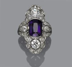An art deco amethyst and diamond ring, circa 1925.