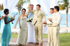 Ceremony at a Cancun wedding at the Riu Palace Peninsula. Happiness!  Mexico wedding photographers Del Sol Photography