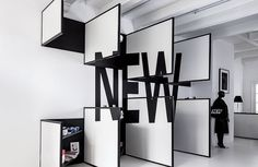 Painted black lines transform into lettering at Amsterdam's Frame Store by I29 Interior Architects.