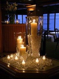 the simplest things can be stunning - crystals, candles & V shape vases