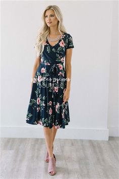 Whenever we find a beautiful dress that is nursing friendly as well we always add it to our collection! This super soft and beautiful navy dress features a pink and sage floral print, cross over front with tie waist sash.