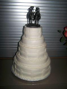 weddin cake with a cute western cake topper