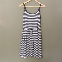"Gray & White Striped Tank Dress w/ Pockets Brand new GAP striped dress in perfect condition with tags. Size XS, could easily fit up to a Small, and adjustable straps. Made up of 35% Cotton and 53% Polyester. Measurements taken flat are 15"" from Pit to Pit, 28.5"" in Length, and  14.5"" Waist. Please ask if you have any questions. Bundle and Save GAP Dresses"