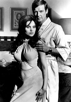 """Miss Caruso (Madeline Smith and Hammer Film Girl) and James Bond (Roger Moore) in """"Live and Let Die"""", Roger Moore 007, Best Bond Girls, James Bond Women, James Bond Style, Madeline Smith, George Lazenby, Bond Series, Timothy Dalton, James Bond Movies"""