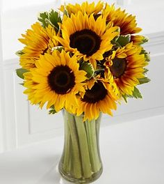 Makes me smile every time i see sunflowers! They were my wedding bouquet