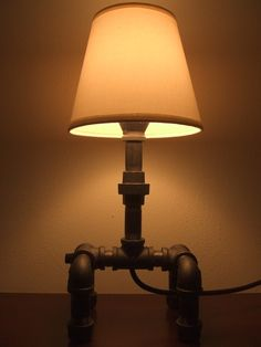 recycled iron pipe lamp