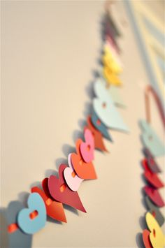 valentines garland - home depot paint chip hearts on a ribbon.