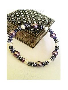 Purple and Cream Bead Stretch Bracelet - £12.00