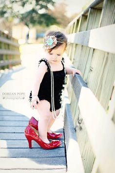 ....  ;) my mom loves to pull out these pics of me like this .... The shoe obsession starts early....   ;)