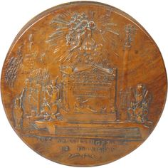 """Antique French Pressed Maple Snuff Box 1815 Waterloo  - This historical item measures a mere 3.25"""" diameter by 5/8"""". It is constructed from the sawn end slice of a section of burr maple. Our lid shows a large tomb with an inscription meaning """"The Imperial guard dies and never surrenders"""". We see an angel above the tomb and soldier and regalia at each side. Below the steps more wording state  """" To the brave dead of 18 June 1815"""". The lift off lid is lined in a horn type shell as is the base."""