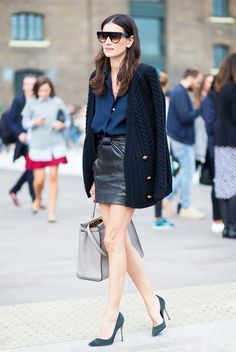 leather miniskirt and blue cardigan