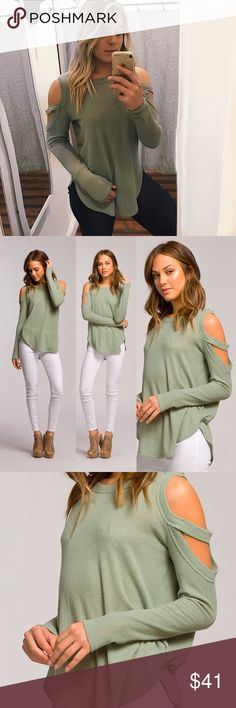 """Show me that shoulder top Loose fit, round neck, long sleeve top. Cold shoulder sleeves with strap. Very rounded hems. This top is made with heavyweight, low gage thermal knit fabric that is soft, drapes well and stretches well. Fabric : 49% Polyester, 49% Rayon, 2% Spandex small 26"""" long bust 17"""" Tops Tees - Long Sleeve"""
