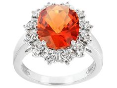 3.96ct Oval Lab Created Padparadscha Sapphire With .79ctw White Topaz