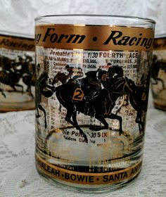 6 Vintage Rocks Glasses Old Fashioned Bar Glasses RACING FORM Horse Racing Barware Black & Gold Foil Race Horse Odds OTB Famous Race Tracks.  Vintage item Materials: glass, black and gold foil design, Santa Anita, Arlington, Churchill Downs, Pimlico, Aqueduct, Hialeah, Bowie, Race Horses, Jockeys  **************************************************  A set of six gorgeous black and gold foil Hollywood Regency Old Fashioned Tumblers - the ultimate in glam decor bar/cocktail ware for hor...