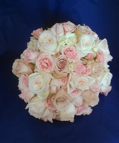 Five varieties of roses, including fragrant O'Hara and quicksand garden roses, are the centerpiece of this beautiful bouquet, which also includes hydrangeas, for a contrasting texture.  See more wedding bouquets, centerpieces, and more at www.jeffmartinsweddings.com