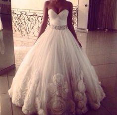 Unique beautiful wedding dress. Full wedding gown. Sweet heart neckline. Flower detailing.