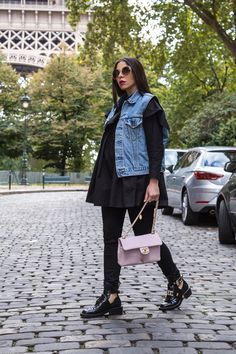 Off-Duty Total Black Look With pink Chanel bag, Levis denim vest and Balenziaga boots by Stella Asteria