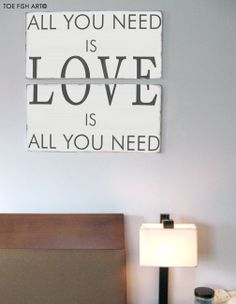 All You Need Is Love Wood Sign - Typography Word Art -Weather Worn White and Charcoal Gray on Wood. $169.00, via Etsy.
