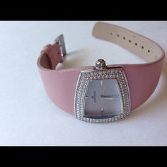 Anne Klein watch Needs a battery. Shimmery pink band. Almost opal like face. Small stain on band (see last picture) Anne Klein Accessories Watches