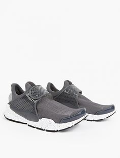 Nike | Grey Sock Dart KJCRD Sneakers | First released in 2004, Nike present an updated iteration of their ground-breaking Sock Dart sneaker. Using computerised technology to knit a single-piece upper of varying density and texture to provide support and flexibility to the foot, the sneakers are presented in a unique grey colourway with distinctive branding throughout.