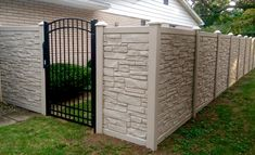 Simtek EcoStone fence w/ arched top aluminum gate. This is one of the most beautiful combinations you can get when it comes to fences.