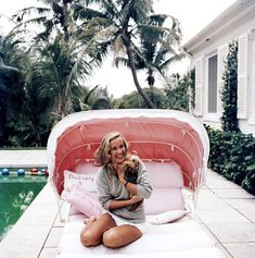 Alice Topping photographed by Slim Aarons poolside in Palm Beach, 1959.