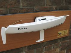 """* This is the 24.5"""" half hull model of the Ultimate 20 class sailboat. The model is built w/ fiberglass using 5 parts model models.   The model dimension is 24.5""""(L) x 9""""(H) x 4.5""""(D). The model weight is 10 LBS. The model scale is 1/10.  ---- Please visit the web at www.halfhull.net or contact Mas at halfhull@gmail.com for more model information.   ----   Zuma Boat  (404) 272-7889."""