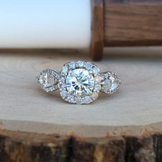 Custom Engagement Ring with a cushion shape halo and two marquise halo accents #JewelerByDesign