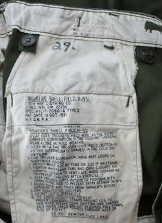 This is a pair of original military issue M-51 field pants made by Stein-Way Clothing Co. in 1952. The pants are in perfect condition, and have no flaws and still have their original color. All hardwa