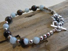 Blue aquamarine bracelet, brown faceted agate, silver faceted beads, white bronze toggle, blue aquamarine round beads by #EyeCandybyCathy on Etsy