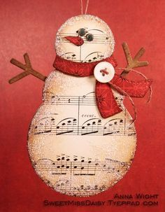 Snowman out of old music paper. Would love this for gift tags. Snowman out of old music paper. Would love this for gift tags. Snowman Crafts, Christmas Projects, Holiday Crafts, Snowman Wreath, Snowman Ornaments, Paper Ornaments, Noel Christmas, Winter Christmas, Handmade Christmas