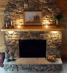 fireplace mantel idea.   Very intrigued by the inset lighting.  (dp)