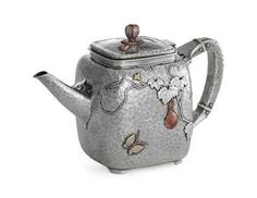 a fine silver and mixed metal teapot mark of Tiffany Co New York_