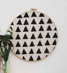 Triangle print hand stamped circle hoop wall decor with gold painted frame on Etsy, $18.00