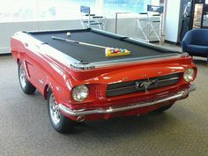 Man Cave Decorating Ideas: What car enthusiast wouldn't want to play pool on a classic Mustang?