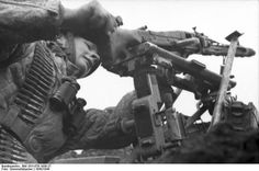 A German paratrooper setting up a MG 42 heavy machine gun, Monte Cassino, Italy.