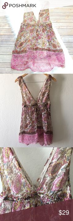 FREE PEOPLE Boho Top Sheer and flowy boho floral print top. Deep v front and back. Bust area is slightly lined but mostly sheer throughout. Elastic empire waist with some fraying, but adds to the look. Pink, yellow, cream, blue in colors. 100% rayon.   Instagram: @bringingupsuns Free People Tops