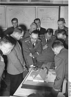 """Exhibition """"Planning and development in the east,"""" Rudolf Hess listens attentively while SS chief Himmler explains. Joachim Peiper, Exhibition Plan, Nuremberg Trials, Global Conflict, Military Units, The Third Reich, Historical Images, World War Ii, Ww2"""