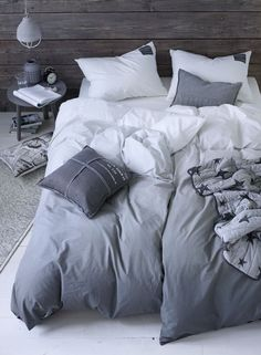 Bedroom in shades of gray with ombre duvet covers