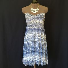 Free People Strapless Dress!  Fun & Flirty blue and white Free People dress!! This is Beautiful on!! It's 100% nylon exterior, so light and airy it feels like gauze. Has a 100% rayon jersey full body lining! It's so comfortable and stays in place and you don't even need to wear a bra. This dress flows beautifully. I am in love with this dress!  It's in impeccable condition!  Free People Dresses Strapless