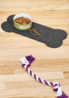 Consider using an old rubber welcome mat to fashion a crumb-catching placemat for your sloppy-eating pooch!  Bone Appetit Pet Place Mat, #ModCloth